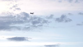 Business jet flies in the sky with clouds stock video footage