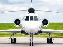 Business Jet Front with grass and sky stock photo
