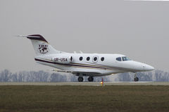 Business Jet Hawker Beechcraft Premier IA. Hawker Beechcraft Premier IA (UR-PSA) lined up and ready for takeoff runway 25 at Kharkiv International Airport Royalty Free Stock Image