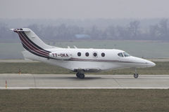 Business Jet Hawker Beechcraft 390 Premier. Private Hawker Beechcraft 390 Premier takeoff from Kharkiv International Airport Stock Images