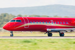 Business jet heading on the runway. In a summer airport royalty free stock photography
