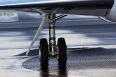 Business JET Landing Gear. Business JET FALCON 2000EX wing landing gear shot Royalty Free Stock Photography