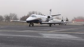 Business jet plane taxiing stock video footage
