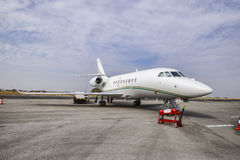 Business jet on a runway Stock Image