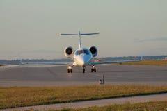 Business jet on runway Stock Photo