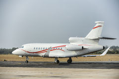 Business jet on runway Stock Photo