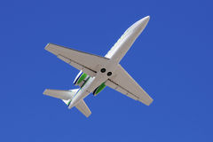 Business jet in the sky Stock Images