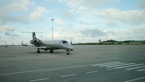 Business jet - small passenger aircraft plane at the airport runway stock video