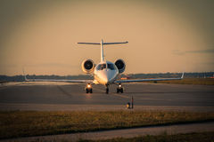 Business jet taxiing along the runway Royalty Free Stock Photo