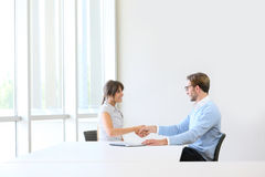 Business job interview. Businessman receiving candidate on job interview Stock Photo