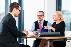 Business - Job Interview with candidate and HR Royalty Free Stock Image