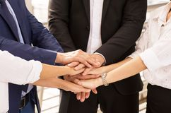 Business join hand success for dealing,Team work to achieve goals,Hand coordination. Business people join hands success for dealing,Team work to achieve goals royalty free stock image