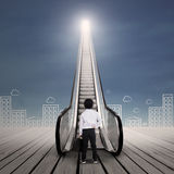 Business kid at escalator with cityscape Stock Image