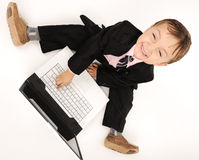Business kid  with laptop Stock Images