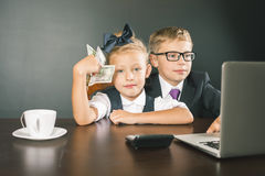 Business kids, children using laptop. Internet games Royalty Free Stock Images