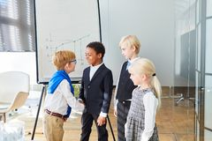 Business kids greet each other with a handshake. Before the negotiations in the office royalty free stock photography