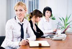 Business ladies in office Royalty Free Stock Photo