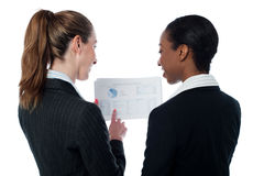 Business ladies reviewing documents stock photography
