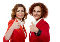 Business ladies thumbs up Stock Photo