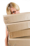 Business Lady #25. Blond Business woman carrying boxes royalty free stock image