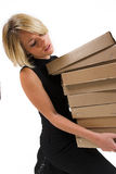 Business Lady #26. Blond Business woman carrying boxes royalty free stock photography