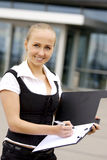 Business lady behind office building. Royalty Free Stock Photography