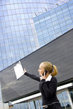 Business lady behind office building. Royalty Free Stock Photo