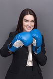 Business lady in boxing gloves Royalty Free Stock Photography