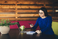 Business lady call on phone in office hub. Young business lady call on phone in office hub Royalty Free Stock Image