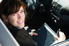 Business lady in a car Royalty Free Stock Photography