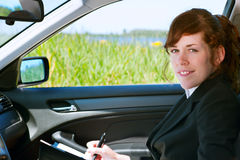 Business lady in a car Stock Photos