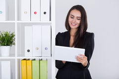 Business lady checking her mail Royalty Free Stock Image