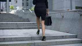Business lady climbing stairs to office center, career ladder, success promotion