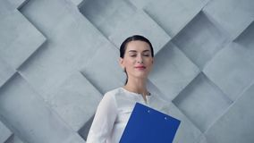 Business lady with clipboard posing for camera stock footage