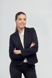 Business lady with crossed hands Royalty Free Stock Photos