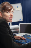 Business lady at a desk Stock Image