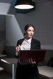Business lady dressed in suit and with laptop; Royalty Free Stock Photo