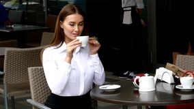 Business lady drinking coffee stock video