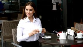 Business lady drinking coffee in cafe Royalty Free Stock Photography