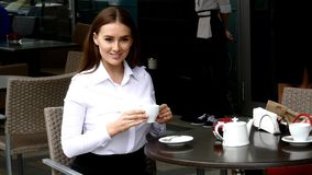 Business lady drinking coffee in cafe Stock Image