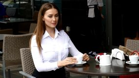 Business lady drinking coffee in cafe Stock Photography
