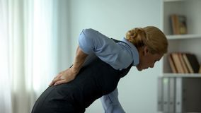 Business lady feeling lower back pain, nerve inflammation, sedentary life result