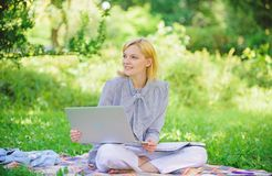 Business lady freelance work outdoors. Become successful freelancer. Woman with laptop sit on rug grass meadow. Online. Freelance career concept. Pleasant stock photography
