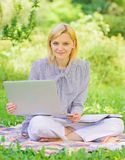 Business lady freelance work outdoors. Become successful freelancer. Woman with laptop sit on rug grass meadow. Online. Freelance career concept. Guide starting stock photos
