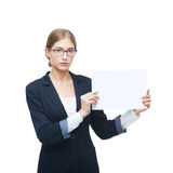 Business lady in glasses holds blank card. Isolated on white Royalty Free Stock Image