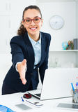 Business lady   greeting someone at desk. Business lady with dark hair greeting someone at desk Stock Photos