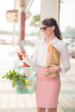 Business lady with groceries Royalty Free Stock Photo