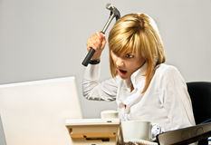 Business Lady with a Hammer Royalty Free Stock Photography