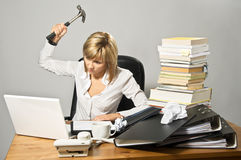 Business Lady with a Hammer. Angry business lady hitting a laptop with a hammer stock images