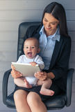 Business lady with her baby Royalty Free Stock Images